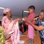 *Mrs Suswan presenting a cheque to an orphan