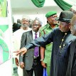 President Goodluck Jonathan (2r) points at the photograph of Former President Olusegun Obasanjo while the newsPhotographer, George Esiri (r); Information Minister, Mr. Labaran Maku (far left) and others watch during the photo exhibition