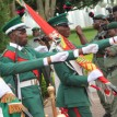 Men of the Colour Party on parade during the exchange of Presidential Guards as part of events to mark the 51st National Day Celebrations at the State House, Abuja. Photo by Abayomi Adeshida