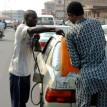 A motorist refueling his car at a black market