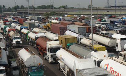 GRIDLOCK—The traffic gridlock at the Mile 2 end of Apapa-Oshodi Expressway, Lagos ,yesterday. Photo: Joe Akintola, Photo Editor.