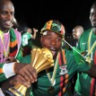 Zambia national football team players celebrate their victory with their trophy at the end of the African Cup of Nations final football match between Zambia and Ivory Coast on February 12, 2012, at the Stade de l'Amitie in Libreville. AFP PHOTO