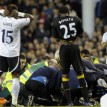 Tottenham and Bolton players stand by as English midfielder Fabrice Muamba is treated by medical staff after collapsing during the English FA Cup quarter-final football match between Tottenham Hotspur and Bolton Wanderers at White Hart Lane in north London, England on March 17, 2012. The game was abandoned at half-time as Muamba was taken to hospital. AFP PHOTO
