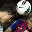 "Real Madrid's Portuguese forward Cristiano Ronaldo (L) heads the ball next to Barcelona's Chiliean forward Alexis Sanchez (R) during the Spanish League ""El clasico"" football match Barcelona vs Real Madrid at the Camp Nou stadium in Barcelona on April 21, 2012. Real Madrid won 1-2.  AFP PHOTO"