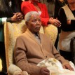 Nelson Mandela made his first appearance in six months when he received a symbolic flame to mark the ruling ANC party's centenary at his rural home in Qunu, in an event shown on television. A healthy-looking Mandela, seated on an armchair, smiled as the African National Congress (ANC) chairwoman Baleka Mbete presented him with the flame emblazoned with the party colours. AFP