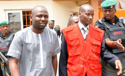 Former Chairman, House Committee on Capital Markets, Rep. Herman Hembe being led by EFCC Officials when he appeared at the High Court on charges of fraud in Abuja on Thursday
