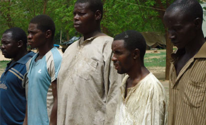 Five of seven suspected terrorists arrested by  JTF  in connection with Last Sunday's attack on Eyn Church in Biu, paraded in Maiduguri, Borno on Thursday (21/6/12). NAN Photo