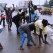 ACN supporters sweeping the road at Ugbowo road, after the announcement of the Edo Governorship Election result in Benin on Sunday (15/7/12). NAN photos