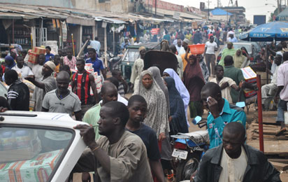 Crowd at the  Abubakar Gunmi Central Market in Kaduna State on June 24 after relaxation of 24hrs curfew engendered  by multiple bomb attacks which killed many in the state  Photo by Olu Ajayi.