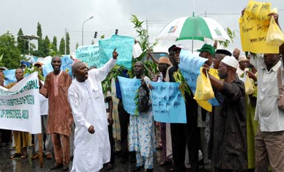 *Cross section of pensioners defying the downpour during a peaceful protest against non-payment of their entitlements at the Federal Secretariat, Abuja. Photo by Abayomi Adeshida