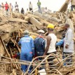 NEMA and NSCDC officials looking for victims  from the rubble of the collapsed building in Kubwa, Abuja. Photo by Gbemiga Olamikan.
