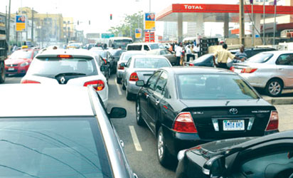 File photo: Long queue at a  petrol filling station