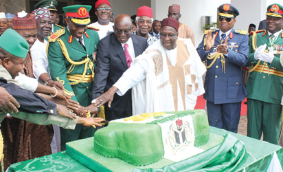 52ND ANNIVERSARY CAKE: President Goodluck Jonathan flanked by former Head of State, Gen. Yakubu Gowon (third left); Senate President, Senator David Mark, former Vice President, Dr Alex Ekwueme; Vice Prresident Namadi Sambo (second left) and other dignitaries during the cutting of the anniversary cake after the Presidential Change of Guards Parade at the Forecourts of the Presidential Villa, as part of activities marking Nigeria's 52nd Independence anniversary, in Abuja, yesterday. Photo: Abayomi Adeshida.