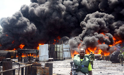 File photo: JTF destroying illegal refineries in Niger Delta communities.