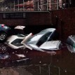NEW YORK, NY - Cars floating in a flooded subterranian basement following Hurricaine Sandy on October 30, 2012 in the Financial District of New York, United States. The storm has claimed at least 16 lives in the United States, and has caused massive flooding accross much of the Atlantic seaboard. US President Barack Obama has declared the situation a 'major disaster' for large areas of the US East Coast including New York City.   AFP