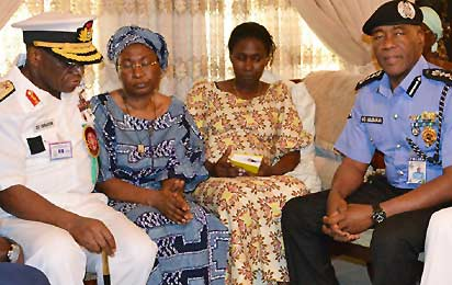 CONDOLENCE—From Left: Admiral Ola Sa`Ad Ibrahim, Chief of Defence Staff; Mrs Alero Azazi, widow; daughter, and  Mr. Mohammed Abubakar, Inspector-General of Police during a condolence visit to late General Azazi's family, yesterday, in Lagos.