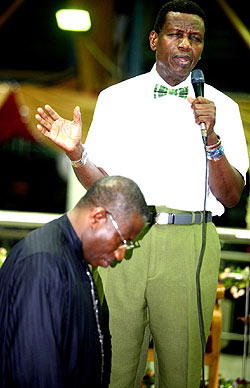 Pastor Adeboye praying for Jonathan