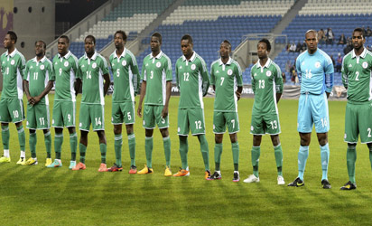 Nigeria's players listen to their national anthem before the Nigeria vs Cape Verde friendly football match in preparation for the CAN 2013 tournament at Algarve Stadium in Faro on January 9, 2013 . AFP PHOTO / FRANCISCO LEONG