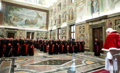 "Pope Benedict XVI (backing camera) delivering a speech to cardinals in the Vatican's ornate Clementine Hall at the Vatican. Pope Benedict XVI vowed ""unconditional obedience"" to his successor on his historic final day as leader of the world's 1.2 billion Catholics, when he will become the first pontiff to resign since the Middle Ages. AFP Photo"