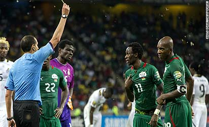 Burkina Faso's Jonathan Pitroipa is shown a second yello card in his side's semifinal win over Ghana.