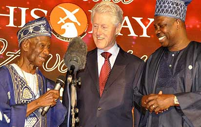 L-R: Teacher Emeritus and nonagenarian, Pa Dotun Oyewole; former President of the United States, Mr Bill Clinton; and Ogun State Governor, Senator Ibikunle Amosun; during the 18th Annual ThisDay Awards to celebrate Nigeria's Best Teachers, at the newly redesigned June 12 Cultural Centre, Abeokuta...yesterday