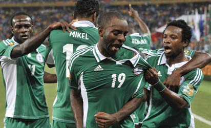 Nigeria's forward Sunday Mba (C) celebrates with teammates after scoring the opening goal against Burkina Faso during the 2013 African Cup of Nations final football match between Burkina Faso and Nigeria on February 10, 2013 at Soccer City stadium in Johannesburg. AFP PHOTO