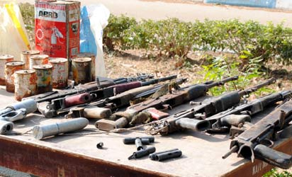 ARMS & AMMUNITION: Assault rifles, ammunition and bomb making items recovered by men of the Nigerian Army in the house of a politician, Hon. Hussaini Dei Dei,along Sabon Birni Road, Kawo, in Kaduna metropolis, Tuesday. Photos: Olu Ajayi.