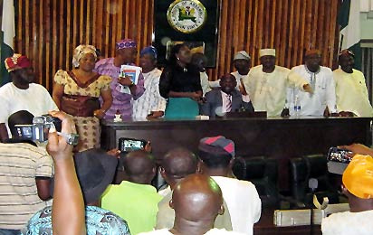 *   Ogun State House of Assembly in a Rowdy Session PIx: Show the Opposition Honourable Members Take Over the Hollow Chamber of the House. - Photo By WUMI AKINOLA