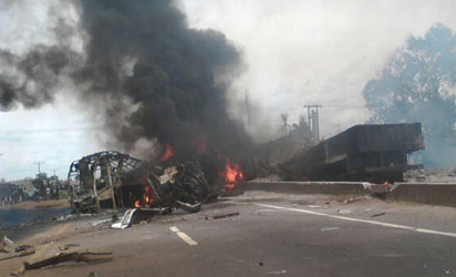 Sene of the accident involving a luxury bus, trailer and tanker at Ugbogui Village along Benin-Ore Express road