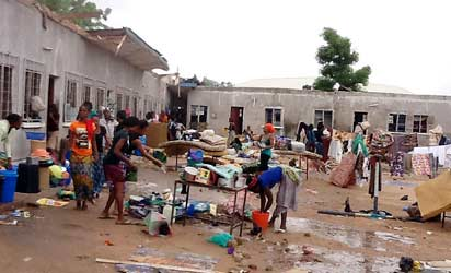 Students of Adamawa State Polytechnic in Yola, packing their belongings following a heavy rainstorm that destroyed their hostels, yesterday morning. PHOTO: NAN.