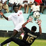 Red Arrows striker Judge Mkandawire dashes for the ball over Ocean Boys goalkeeper Iboro Akpakpan during the African Confederation Cup first round, first leg match played at Nkoloma Stadium in Lusaka