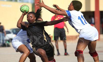 A female handball player sandwiched during a handball match in Abuja.